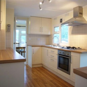 New kitchen in refurbished home at Merrywood Park, Box Hill, Surrey